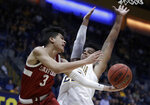 Stanford's Tyrell Terry (3) passes the ball away from California's Andre Kelly in the first half of an NCAA college basketball game Sunday, Jan. 26, 2020, in Berkeley, Calif. (AP Photo/Ben Margot)