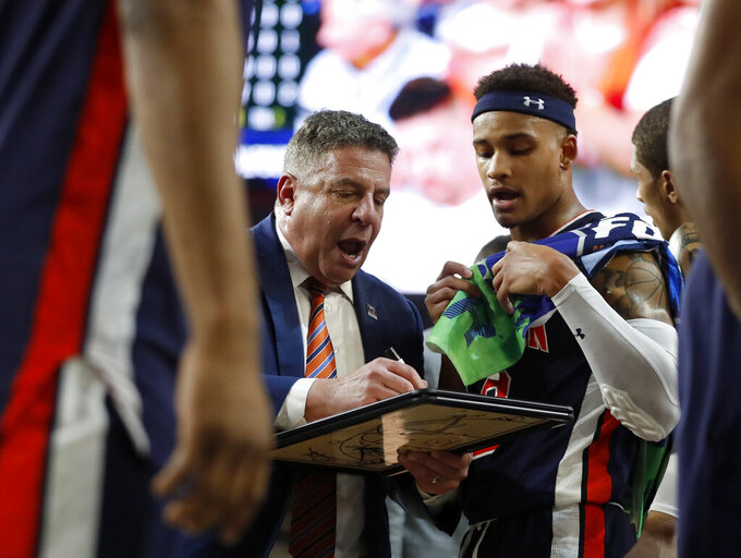 Auburn head coach Bruce Pearl talks to Bryce Brown during a time out during the second half in the semifinals of the Final Four NCAA college basketball tournament, Saturday, April 6, 2019, in Minneapolis. (AP Photo/Jeff Roberson)