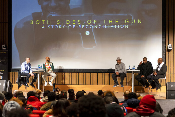 From left, former U.S. Secretary of State Arne Duncan, rapper Common, William Moore, and brothers of the late Ben Wilson, Anthony and Jeffrey Wilson, speak at Malcom X College during a conversation and private screening of