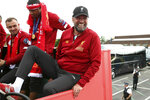 Liverpool soccer team manager Jurgen Klopp, rides an open top bus during the Champions League Cup Winners Parade in Liverpool, England, Sunday June 2, 2019.  Liverpool is champion of Europe for a sixth time after beating Tottenham 2-0 in the Champions League final played in Madrid Saturday. (Barrington Coombs/PA via AP)