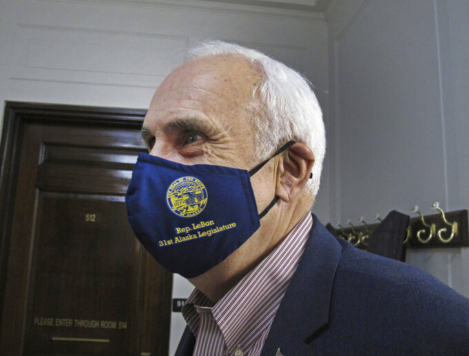 Alaska state Rep. Bart LeBon, a Fairbanks Republican, poses in a mask bearing his name outside a committee room in the state Capitol in Juneau, Alaska, Monday, Jan. 18, 2021. The new Legislature is set to convene on Tuesday, Jan. 19, 2021. (AP Photo/Becky Bohrer)