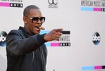 FILE - In this Sunday, Nov. 24, 2013, file photo, R. Kelly arrives at the 2013 American Music Awards, in Los Angeles. A federal jury in New York convicted the R&B superstar Monday, Sept. 27, 2021, in a sex trafficking trial. (Photo by Matt Sayles/Invision/AP, File)