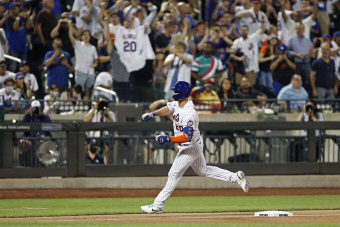 New York Mets' Pete Alonso celebrates as he rounds third base after hitting a solo home run against the Toronto Blue Jays during the eighth inning of a baseball game Friday, July 23, 2021, in New York. (AP Photo/Adam Hunger)