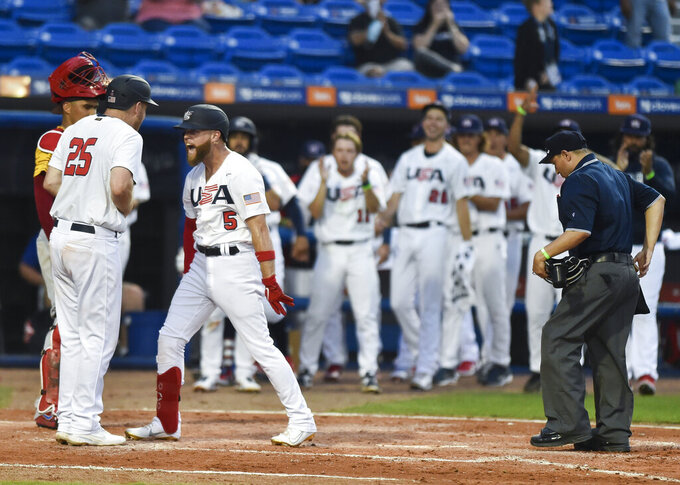 United States' Eric Filia (5) celebrates his home run with Todd Frazier (25) during the fourth inning against Venezuela in an Americas qualifying tournament baseball game Saturday, June 5, 2021, in Port St. Lucie, Fla. (Crystal Vander Weit/TCPalm.com via AP)