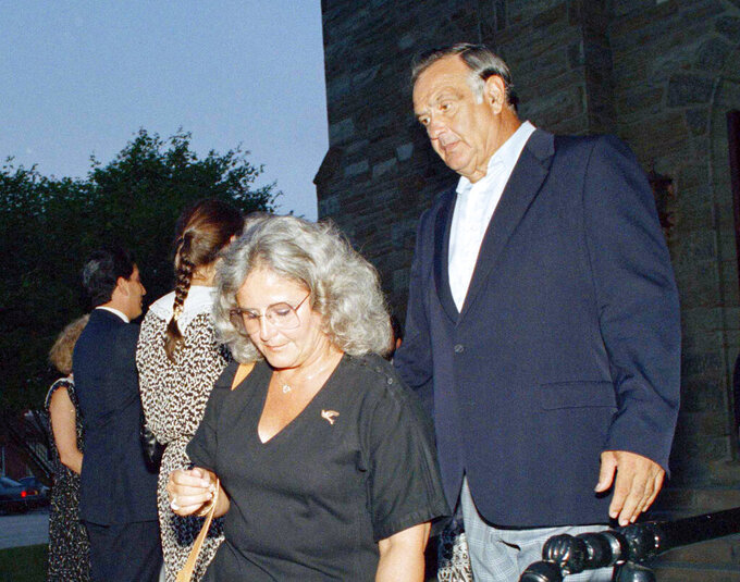 RETRANSMISSION TO CORRECT AGE TO 93 - FILE - In this Aug. 10, 1988, file photo, former Baltimore Colts football great Gino Marchetti, right, with his wife Joan, leaves St. Patrick's Church in Malvern, Pa., after attending a wake for teammate Alan Ameche. Marchetti, an undersized Hall of Fame defensive tackle who helped the Baltimore Colts win two NFL championships, has died. He was 93. (AP Photo/Robert J. Gurecki, File)