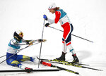 Gold medal winner Stina Nilsson, of Sweden, left, celebrates with silver medal winner Maiken Caspersen Falla, of Norway, after the women's cross-country skiing sprint classic at the 2018 Winter Olympics in Pyeongchang, South Korea, Tuesday, Feb. 13, 2018. (AP Photo/Matthias Schrader)