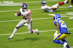 New York Giants running back Devonta Freeman (31) runs against the Los Angeles Rams during the first half of an NFL football game Sunday, Oct. 4, 2020, in Inglewood, Calif. (AP Photo/Ashley Landis)