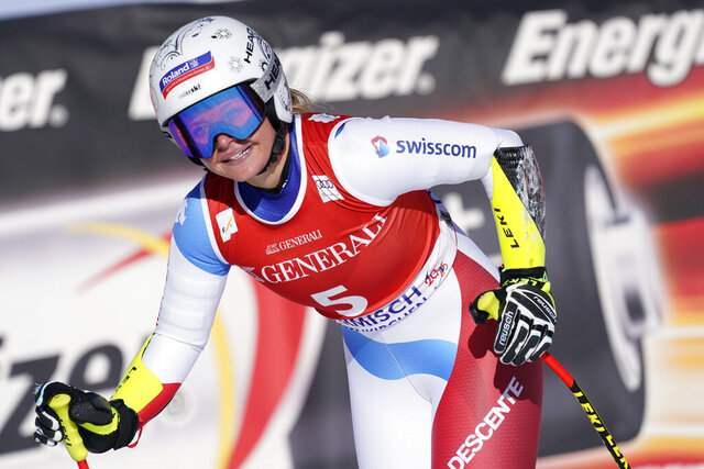 Switzerland's Corinne Suter reacts in the finish area of an alpine ski, women's World Cup super G, in Garmish Partenkirchen, Germany, Sunday, Feb. 9, 2020. (AP Photo/Giovanni Auletta)