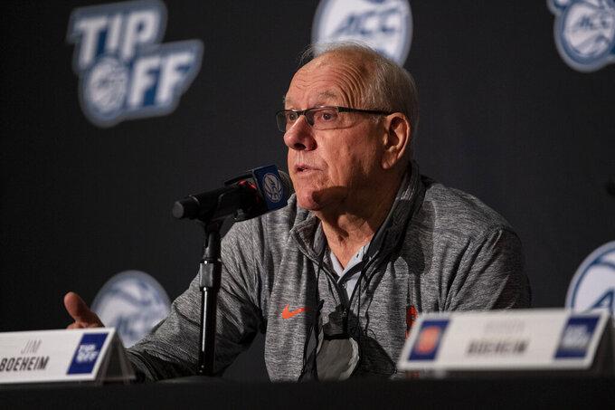 Syracuse head coach Jim Boeheim speaks during NCAA college basketball Atlantic Coast Conference media day, Tuesday, Oct. 12, 2021, in Charlotte, N.C. (AP Photo/Matt Kelley)