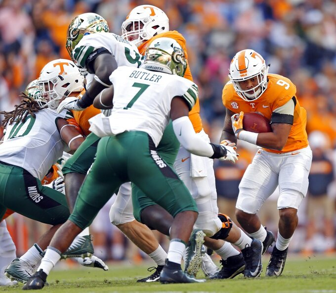 Tennessee running back Tim Jordan (9) runs for yardage in the first half of an NCAA college football game against Charlotte Saturday, Nov. 3, 2018, in Knoxville, Tenn. (AP Photo/Wade Payne)