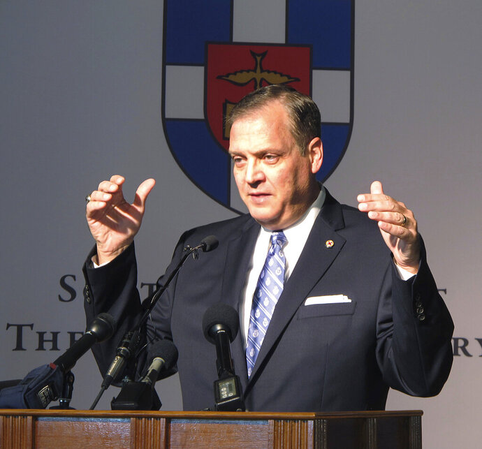 FILE - In this Monday, Oct. 5, 2015 file photo, The Rev. R. Albert Mohler Jr., president of Southern Baptist Theological Seminary, speaks to reporters about a conference in Louisville, Ky., focusing on homosexuality and how to offer pastoral care to gays. Mohler, a prominent leader in the Southern Baptist Convention says he was wrong to support a Kentucky pastor accused of covering up sex abuse. The Rev. Albert Mohler first addressed the issue Thursday, Feb. 14, 2019 in an interview with the Houston Chronicle .(AP Photo/Bruce Schreiner, File)