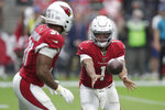 Arizona Cardinals quarterback Kyler Murray (1) hands off to running back David Johnson during the first half of an NFL football game, Sunday, Sept. 8, 2019, in Glendale, Ariz. (AP Photo/Darryl Webb)