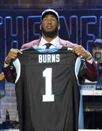 Florida State defensive end Brian Burns poses with his new jersey after the Carolina Panthers selected Burns in the first round at the NFL football draft, Thursday, April 25, 2019, in Nashville, Tenn. (AP Photo/Steve Helber)