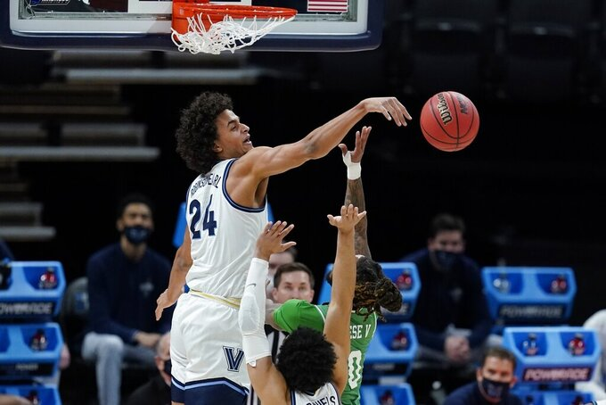 Villanova's Jeremiah Robinson-Earl (24) blocks the shot of North Texas' James Reese (0) during the first half of a second-round game in the NCAA men's college basketball tournament at Bankers Life Fieldhouse, Sunday, March 21, 2021, in Indianapolis. There was a notion that Villanova was kind of an afterthought in the NCAA Tournament, even with a five seed and all that experience. It's hard to think of Villanova as needing a chip on its shoulder, but it's got one. They'll need it against No. 1 Baylor. (AP Photo/Darron Cummings)