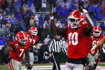 Georgia's D'Andre Swift (7) celebrates with wide receiver Kearis Jackson (10) and the rest of his teammates after scoring a touchdown in the second half against Kentucky during an NCAA college football game Saturday, Oct. 19, 2019, in Athens, Ga. (Joshua L. Jones/Athens Banner-Herald via AP)