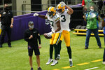Green Bay Packers wide receiver Davante Adams (17) celebrates with teammate Allen Lazard (13) after catching a 24-yard touchdown pass during the first half of an NFL football game against the Minnesota Vikings, Sunday, Sept. 13, 2020, in Minneapolis. (AP Photo/Jim Mone)