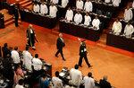 Sri Lankan president Gotabaya Rajapaksa, center, along with speaker Karu Jayasuriya, center left, walk in the well of the house as he arrives to address the ceremonial inauguration of the session in Colombo, Sri Lanka, Friday, Jan. 3, 2020. (AP Photo/Eranga Jayawardena)