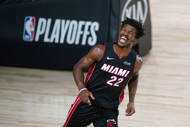 Miami Heat forward Jimmy Butler (22) reacts after scoring against the Indiana Pacers during the second half of an NBA basketball first round playoff game, Tuesday, Aug. 18, 2020, in Lake Buena Vista, Fla. (AP Photo/Ashley Landis, Pool)