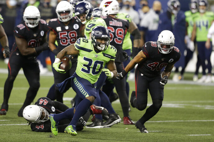 Seattle Seahawks running back Carlos Hyde (30) rushes against the Arizona Cardinals during the first half of an NFL football game, Thursday, Nov. 19, 2020, in Seattle. (AP Photo/Lindsey Wasson)