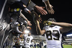 Georgia Tech wide receiver Brad Stewart (83) and quarterback Tobias Oliver (8) celebrate with fans after an NCAA college football game against Miami on Saturday, Nov. 10, 2018, in Atlanta. Georgia Tech won 27-21. (AP Photo/John Amis)