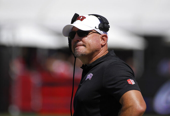 FILE - In this Sept. 1, 2018, file photo, UNLV head coach Tony Sanchez watches the first half of an NCAA college football game against Southern California in Los Angeles. Sanchez is in his fourth season in charge of an uptick Rebels program that has improved by one victory in each of his first three seasons. (AP Photo/Mark J. Terrill, File)