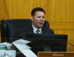 Metro detective Jason Leavitt testifies as he takes the witness stand during a public fact-finding review for the fatal officer involved shooting of Jorge Gomez at the Clark County Government Center, on Friday, April 16, 2021, in Las Vegas. (Bizuayehu Tesfaye/Las Vegas Review-Journal via AP)