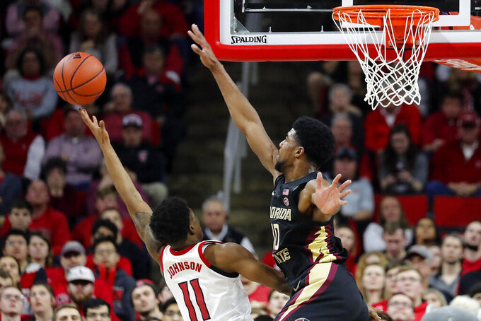 FILE - Florida State's Malik Osborne (10) goes up to block the shot of North Carolina State's Markell Johnson (11) during the second half of an NCAA college basketball game in Raleigh, N.C., in this Saturday, Feb. 22, 2020, file photo. Florida State reached the Sweet 16 in 2019 and '21 behind veteran teams that focus on defense. Leonard Hamilton welcomes a highly regarded signing class to Tallahassee that blends with guard Anthony Polite, forward Malik Osborne as well as transfers Caleb Mills (Houston) and Cam'Ron Fletcher (Kentucky).(AP Photo/Karl B DeBlaker)
