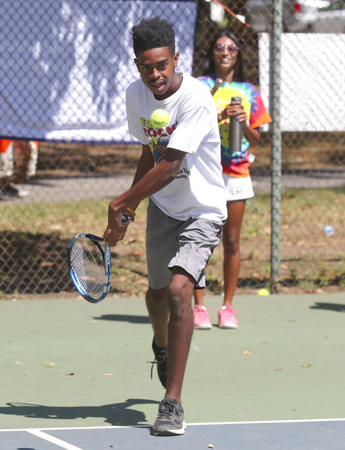 Carter Wilson, 16, of Wilmington, plays during drills in the Tennis Rocks Tutoring and Music Association's last day of its summer session for young people at Haynes Park Thursday, Aug. 5, 2021, in Wilmington, Del. (William Bretzger/The News Journal via AP)