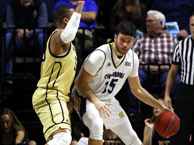 Chattanooga forward Ramon Vila (15) works for a shot against Wofford forward Cameron Jackson during the first half of an NCAA college basketball game Thursday, Feb. 28, 2019, in Chattanooga, Tenn. (AP photo/Wade Payne)