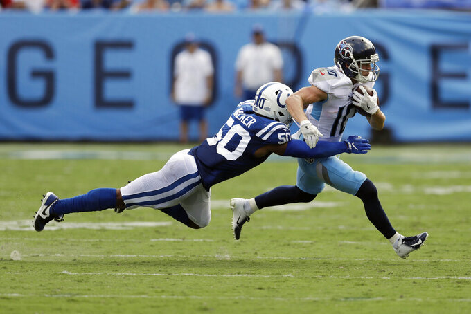Indianapolis Colts middle linebacker Anthony Walker (50) dives for Tennessee Titans wide receiver Adam Humphries (10) in the first half of an NFL football game Sunday, Sept. 15, 2019, in Nashville, Tenn. (AP Photo/James Kenney)