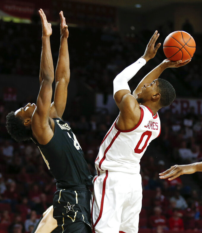 Oklahoma's Christian James (0) shoots against Vanderbilt's Aaron Nesmith (24) during the first half of an NCAA college basketball game in Norman, Okla., Saturday, Jan. 26, 2019. (Nate Billings/The Oklahoman via AP)