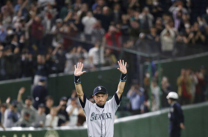 Seattle Mariners right fielder Ichiro Suzuki returns to the field for waiting fans after Game 2 of the Major League baseball opening series against the Oakland Athletics at Tokyo Dome in Tokyo, Thursday, March 21, 2019. The 45-year-old Mariners star announced his retirement Thursday night, shortly after waving goodbye at the Dome. (AP Photo/Koji Sasahara)