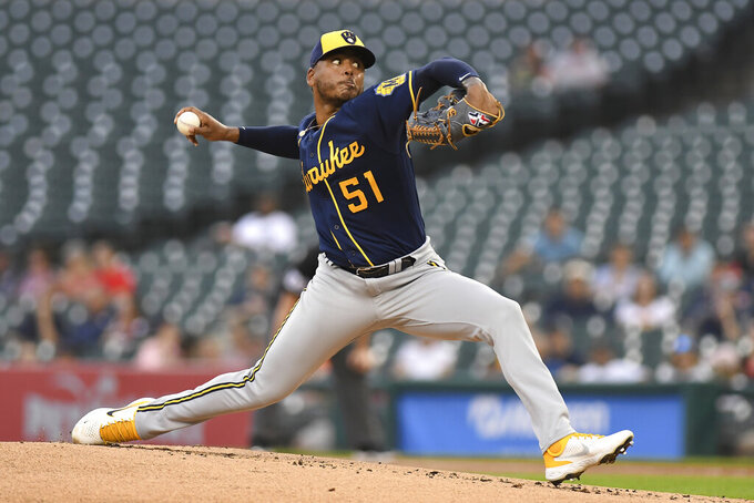 Milwaukee Brewers pitcher Freddy Peralta throws to a Detroit Tigers batter during the first inning of a baseball game in Detroit, Tuesday, Sept. 14, 2021. (AP Photo/Lon Horwedel)