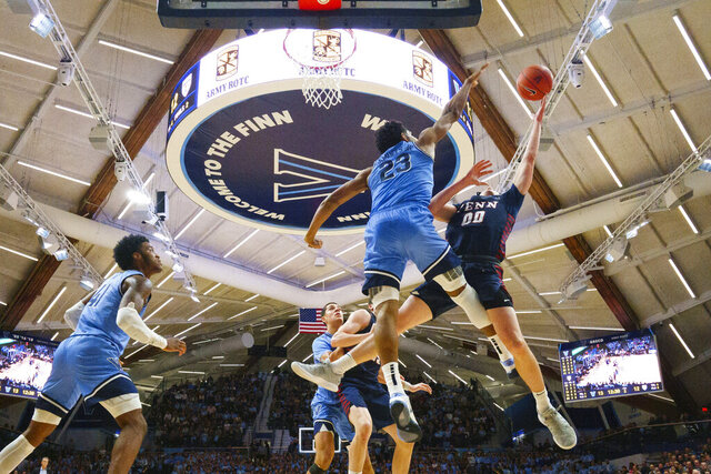 Pennsylvania's Ryan Betley (00) is defended by Villanova's Jermaine Samuels (23) during the first half of an NCAA college basketball game Wednesday, Dec. 4, 2019, in Villanova, Pa. (AP Photo/Matt Slocum)