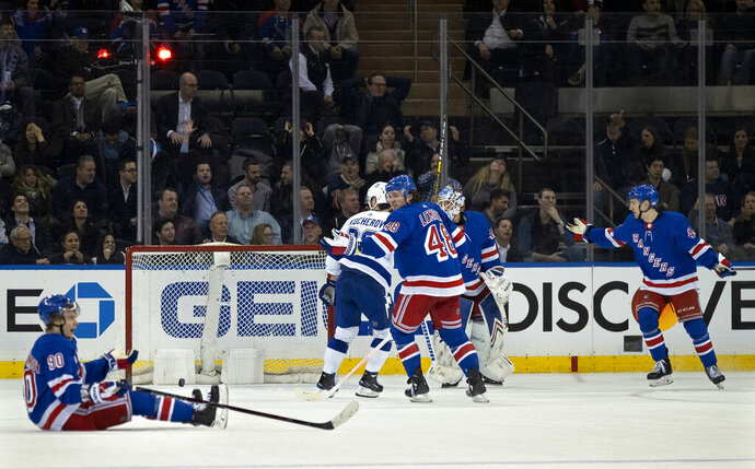 The puck rests in the net after a goal by Tampa Bay Lightning's Victor Hedman, as New York Rangers react in overtime of an NHL hockey game Wednesday, Feb. 27, 2019, at Madison Square Garden in New York. The Lightning won 4-3. (AP Photo/Craig Ruttle)