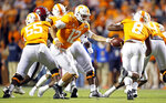 Tennessee quarterback J.T. Shrout (12) hands the ball off to running back Ty Chandler (8) in the second half of an NCAA college football game against South Carolina, Saturday, Oct. 26, 2019, in Knoxville, Tenn. (AP Photo/Wade Payne)