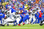Buffalo Bills quarterback Josh Allen (17), center, runs the ball during the first half of an NFL football game against the Philadelphia Eagles, Sunday, Oct. 27, 2019, in Orchard Park, N.Y. (AP Photo/Adrian Kraus)