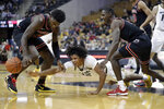 Missouri's Dru Smith, center, reaches for a loose ball between Georgia's Anthony Edwards, left, and Jordan Harris during the second half of an NCAA college basketball game Tuesday, Jan. 28, 2020, in Columbia, Mo. Missouri won 72-69. (AP Photo/Jeff Roberson)