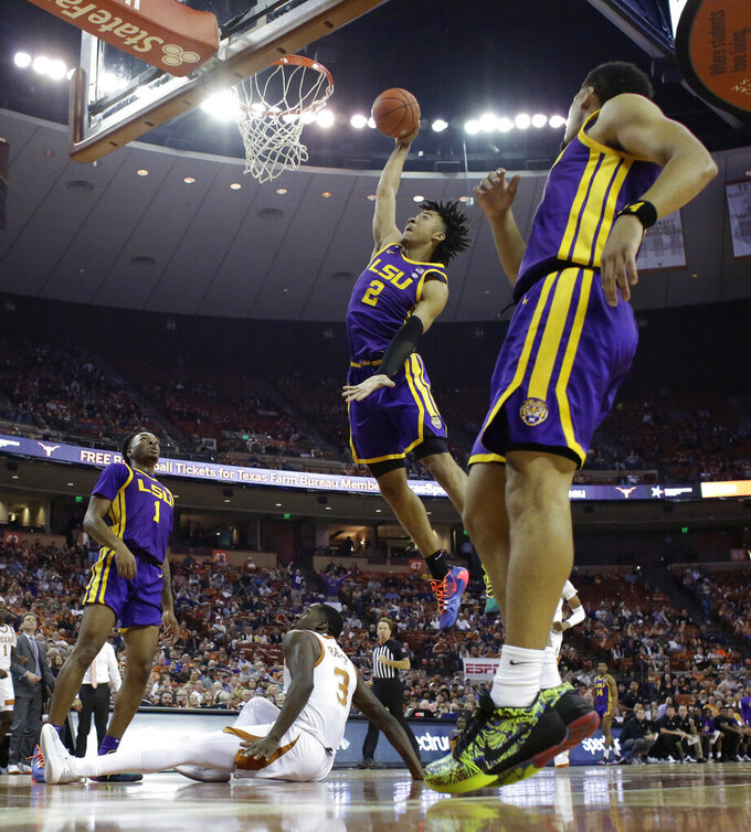 LSU forward Trendon Watford (2) scores over Texas guard Courtney Ramey (3) during the first half of an NCAA college basketball game, Saturday, Jan. 25, 2020, in Austin, Texas. (AP Photo/Eric Gay)