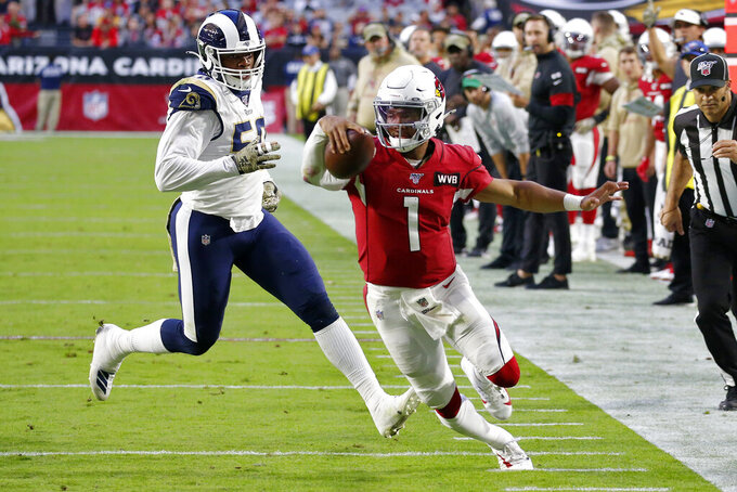 Arizona Cardinals quarterback Kyler Murray (1) runs for a touchdown as Los Angeles Rams outside linebacker Samson Ebukam looks on during the second half of an NFL football game, Sunday, Dec. 1, 2019, in Glendale, Ariz. (AP Photo/Ross D. Franklin)