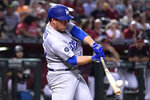 Los Angeles Dodgers' Jedd Gyorko hits an RBI-double against the Arizona Diamondbacks in the fourth inning of a baseball game Saturday, Aug. 31, 2019, in Phoenix. (AP Photo/Rick Scuteri)