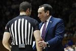 Duke head coach Mike Krzyzewski, right, speaks with an official during the second half of an NCAA college basketball game against Notre Dame in Durham, N.C., Saturday, Feb. 15, 2020. (AP Photo/Gerry Broome)
