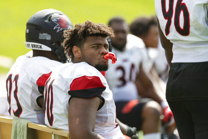 Southeast Missouri State's Michael Harris watches the final minutes of their 59-28 loss to Missouri in an NCAA college football game Saturday, Sept. 18, 2021, in Columbia, Mo. Missouri won 59-28. (AP Photo/L.G. Patterson)