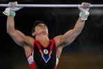 Artur Dalaloyan, of the Russian Olympic Committee, trains on the horizontal bar for the artistic gymnastics at Ariake Gymnastics Centre venue ahead of the 2020 Summer Olympics, Wednesday, July 21, 2021, in Tokyo. (AP Photo/Natacha Pisarenko)