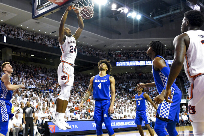 Auburn forward Anfernee McLemore (24) dunks against Kentucky during the second half of an NCAA college basketball game Saturday, Feb. 1, 2020, in Auburn, Ala. (AP Photo/Julie Bennett)