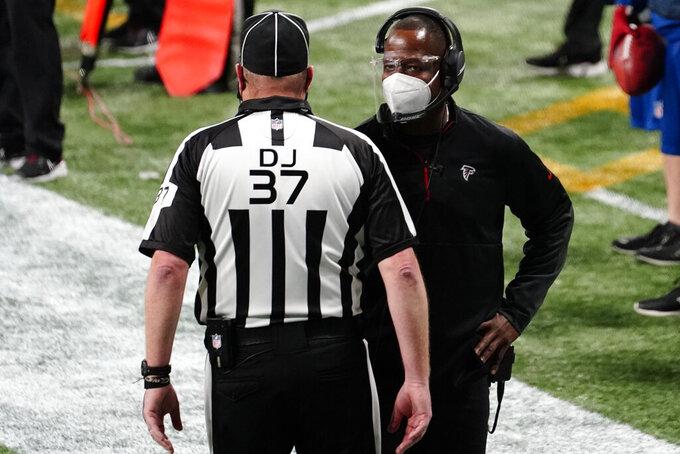 Atlanta Falcons interim head coach Raheem Morris speaks to an official during the second half of an NFL football game against the Las Vegas Raiders, Sunday, Nov. 29, 2020, in Atlanta. (AP Photo/Brynn Anderson)