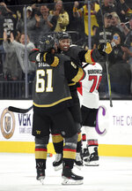 Vegas Golden Knights right wing Mark Stone (61) and center Jonathan Marchessault (81) celebrate after Marchessault's shootout goal against the Ottawa Senators during an NHL hockey game Thursday, Oct. 17, 2019, in Las Vegas. The Golden Knights won 3-2. (AP Photo/David Becker)