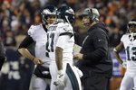 Philadelphia Eagles quarterback Nick Foles (9) talks to wide receiver Alshon Jeffery (17) and head coach Doug Pederson during the second half of an NFL wild-card playoff football game against the Chicago Bears Sunday, Jan. 6, 2019, in Chicago. The Eagles won 16-15. (AP Photo/David Banks)