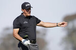 Phil Mickelson yells out as his shot from the fifth tee goes wide left on the Torrey Pines South Course during the first round of The Farmers Insurance golf tournament in San Diego, Thursday, Jan. 23, 2020. (AP Photo/Alex Gallardo)