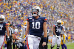 Auburn quarterback Bo Nix (10) celebrates his touchdown in the first half of an NCAA college football game against the LSU in Baton Rouge, La., Saturday, Oct. 26, 2019. (AP Photo/Gerald Herbert)